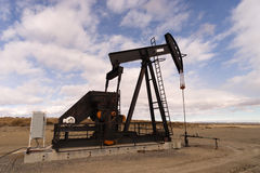 Wyoming Industrial Oil Pump Jack Fracking Crude Extraction Machi Stock Photos