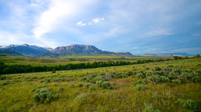Wyoming Landscape. Wyoming rolling plains and ranch land gives way to the edge of the Rocky Mountains Stock Photography