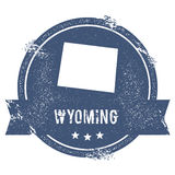 Wyoming mark. Travel rubber stamp with the name and map of Wyoming, vector illustration. Can be used as insignia, logotype, label, sticker or badge of USA Royalty Free Stock Photography
