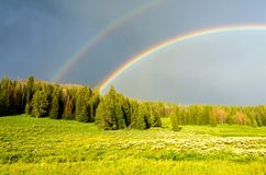 Wyoming Rainbows by the road. stock image