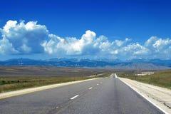 Wyoming road in prairie Stock Photos