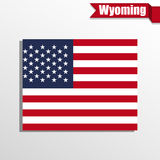 Wyoming State map with US flag inside and ribbon Royalty Free Stock Photos