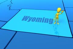 Wyoming state outline with yellow stick figure Stock Images