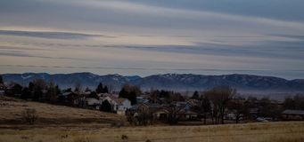 Wyoming Suburbia. This is a landscape photo of a neighborhood of homes together, and a beautiful mountain range background Stock Images