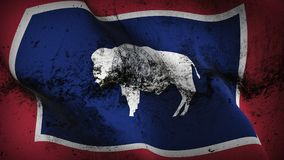 Wyoming US State grunge dirty flag waving on wind. stock photos