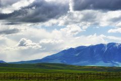 Wyoming Vast Landscape under dark clouds. Views of Wyoming`s ominous cloudy skies over open fields and sections of the Laramie Mountain Range, seen from highway royalty free stock photos
