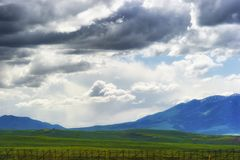 Wyoming Vast Landscape under dark clouds. Views of Wyoming`s ominous cloudy skies over open fields and sections of the Laramie Mountain Range, seen from highway royalty free stock image
