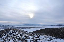Wyoming Winter. Evening sets in over Pathfinder Reservoir in central Wyoming near Casper. Mountain ranges and plains are scattered about in this area Royalty Free Stock Photography