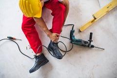 Wypadek mężczyzna pracownik przy budową Odgórny widok zdjęcia stock