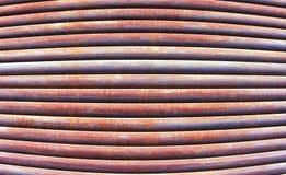 Wypukły światło i czerwony ośniedziały żelazo piszczymy tło teksturę Fotografia Stock