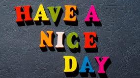 Wyrażeniowy ` ładnego dnia ` robić kolorowi drewniani listy na zmroku stole Obraz Royalty Free