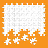 Wyrzynarki łamigłówka składa biel na pomarańczowym tle Zdjęcia Stock