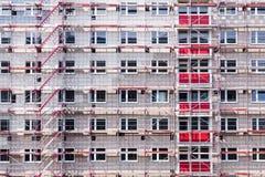 Wysoki budynku dom w rusztowaniu Obraz Royalty Free