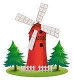Wysoki drewniany budynek z wiatraczkiem Zdjęcie Stock