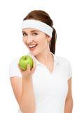 Wysoki kluczowy portret młodej kobiety mienia zieleni jabłko odizolowywający na wh Zdjęcie Royalty Free