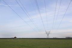 Wysoki woltażu pilon w obszar wiejski północy Amsterdam w Holland Fotografia Stock