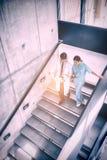 Wysokiego kąta widok lekarka i pielęgniarka dyskutuje nad raportem podczas gdy wspinaczkowi puszków schodki Obraz Royalty Free