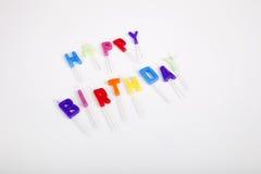 Wysokiego kąta widok urodzinowe świeczki przeciw białemu tłu Obraz Stock