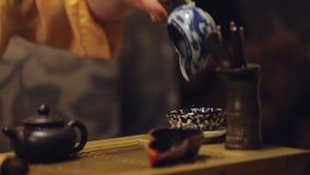 Wystawa herbaciana ceremonia w azjatykciej restauraci, Chińska kultura, set rytuały zbiory wideo