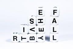 Wytłoczeni kostka do gry literuje out słowa wzrastają i spadają obraz stock