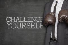 Wyzwanie yourself na blackboard z biznesmenem fotografia stock