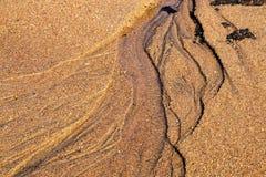 Wzór czochry na Piaskowatej plaży linii brzegowej i tekstury Fotografia Stock