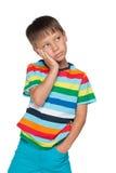 Wzburzona chłopiec w pasiastej koszula obrazy royalty free