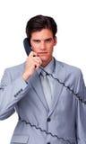 Wzburzony w telefonów drutach biznesmen wzburzona gmatwanina Obraz Stock