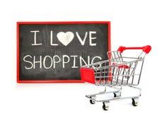 Wózek na zakupy z kredowym pisać słowem Fotografia Royalty Free