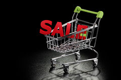 Wózek na zakupy z sprzedaż listami Fotografia Royalty Free