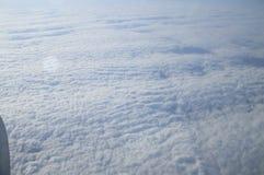 Wznosić się nad koc chmury Fotografia Stock