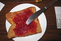 Wznoszący toast dżem i chleb Zdjęcia Stock