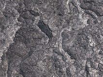 Wzory pękają i kształty wyłaniają się od ten zakończenia w górę porci czerń tężąca lawa Obrazy Royalty Free