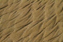 Wzory w piasku plaża zdjęcia stock