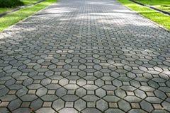 Wzorzyste brukowanie płytki, cementowy ceglany podłogowy tło zdjęcie stock