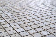 Wzorzyste brukowanie płytki, cementowy ceglany podłogowy tło Obrazy Royalty Free
