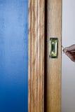 Wzorzysty drewniany i metal drzwi obok błękit ściany fotografia royalty free