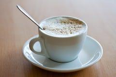 Xícara de café com crema Imagem de Stock Royalty Free