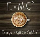 Xícara de café com fórmula fotografia de stock royalty free
