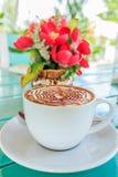 Xícara de café com flor Imagem de Stock Royalty Free