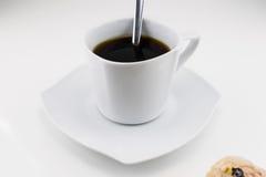 Xícara de café com um bolo Foto de Stock Royalty Free