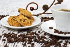 Xícara de café e bolos Imagem de Stock
