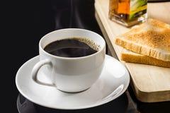 Xícara de café e pães Imagem de Stock Royalty Free