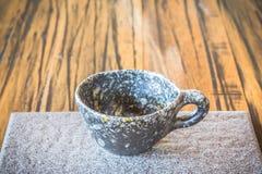 Xícara de café na placa Fotos de Stock
