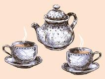Xícaras de chá e bule Fotos de Stock Royalty Free