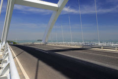 X arch bridge on sea Royalty Free Stock Image
