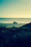 4x4 auf dem Strand bei Sonnenuntergang Lizenzfreie Stockfotografie