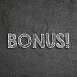 & x22; Bonus& x22; escrito em um quadro imagens de stock royalty free