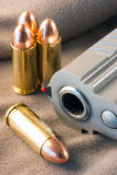 9x21. Bullets 9x21, near a handgun barrell royalty free stock photography