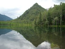 """""""The Cap of Monomakh"""" mountain. Mountain """"The Cap of Monomakh"""" reflected in lake Royalty Free Stock Photos"""